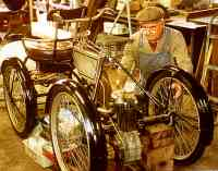photograph: Working on a 1900 Humber Quadricycle.