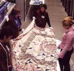 Photograph: Visitors admire a quilt from the famous Beamish Collection.